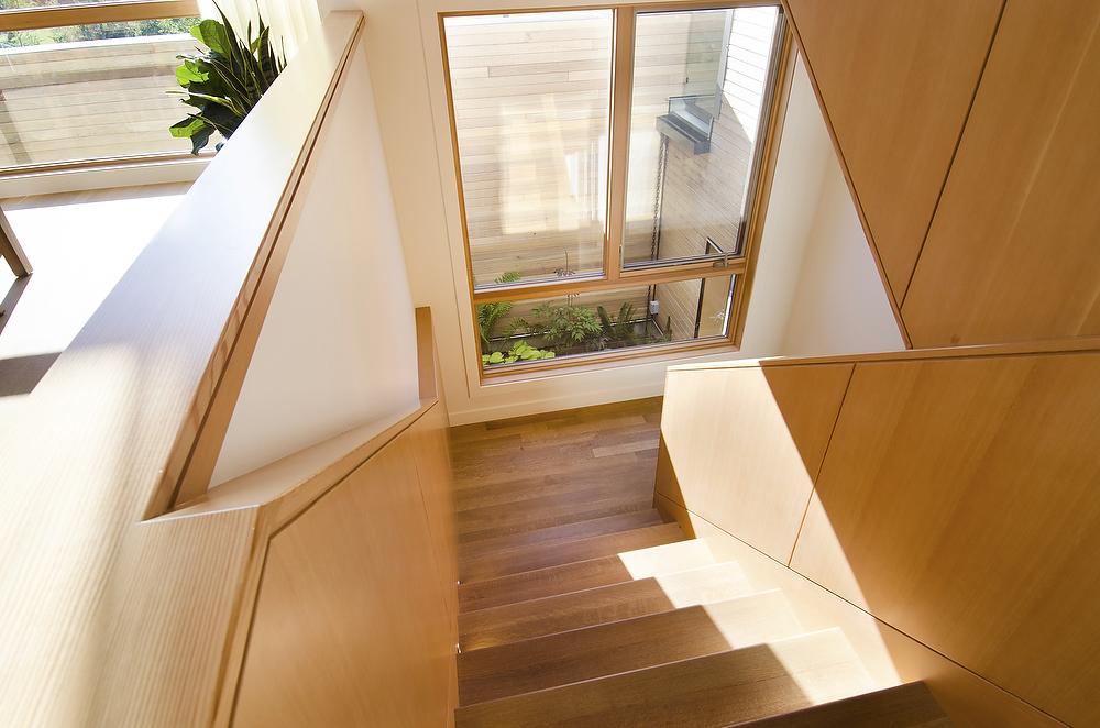 Image of a wood stairway looking down